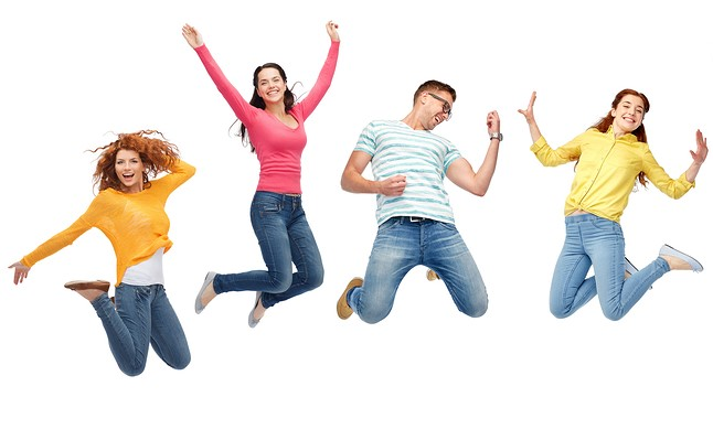 """""""<alt=""""men and women in jeans and colourful tops jumping in air against a white background"""">"""