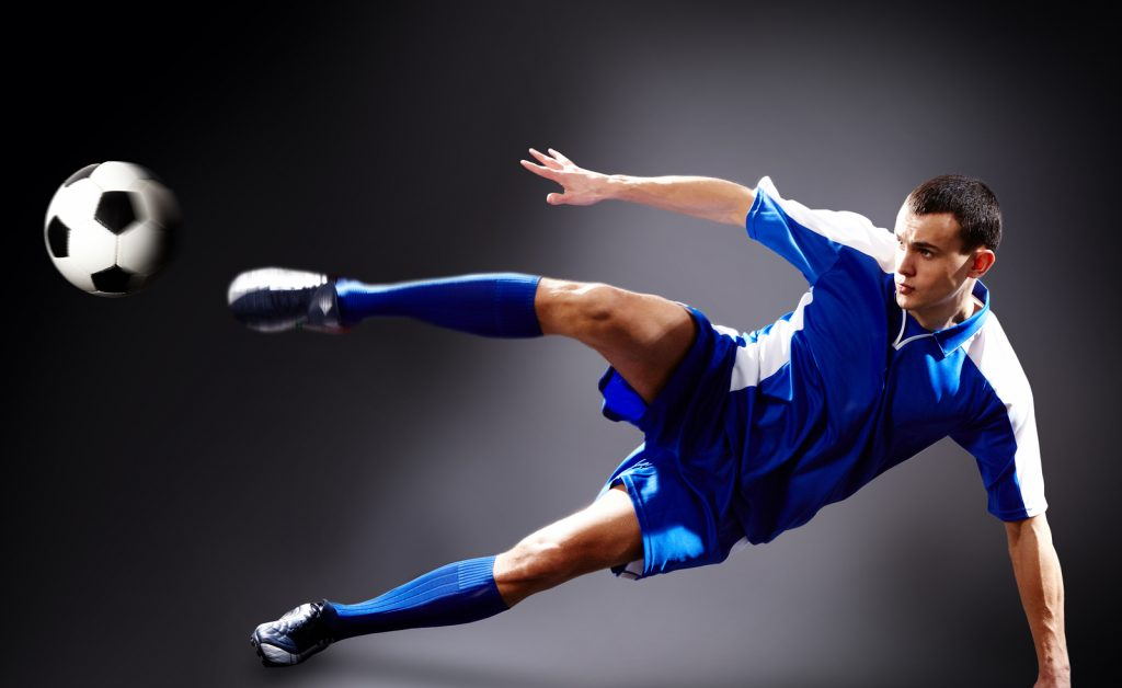 "<alt=""player in blue kick doing a flying kick with ball to illustrate soccer idioms."">"